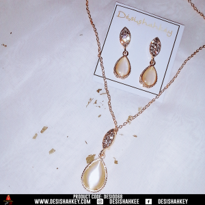 Golden pearl stone locket chain set with earrings.