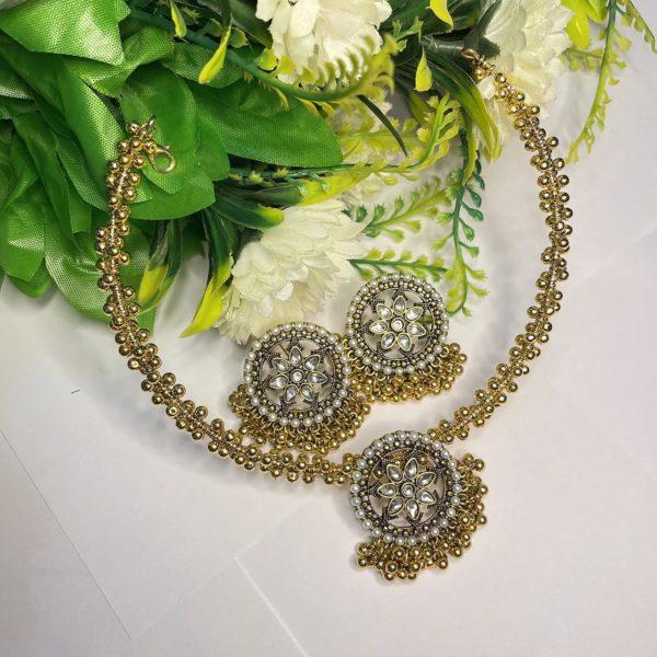 Chand sitara chokar set with golden and offwhite pearls work
